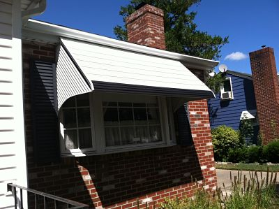 An aluminum picture window awning lets in the necessary light without obstructing views.
