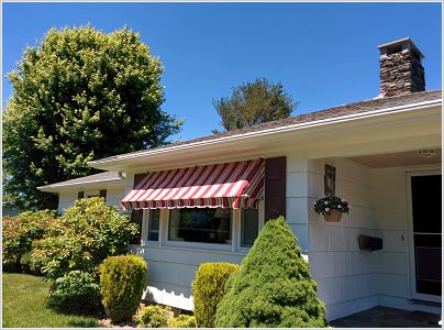 This canvas awning protects this homeowner's living room from the heat of the summer sun.