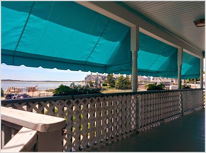 These customers wanted shade on their beachfront porch during the hottest times of the day.  The awnings we provided retract when they want the sun, and go back down when they need some cooling off.