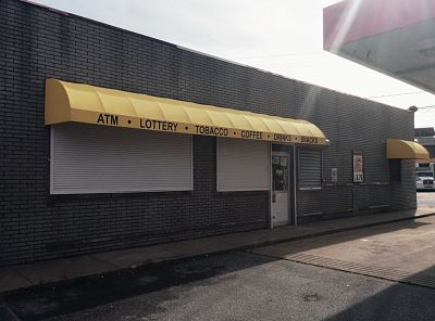 A new gas station on Belville Ave in New Bedford needed to peak the interests on people passing by.  They will succeed in doing just that with a bright yellow awning, and by informing potential customers of exactly what they sell inside.