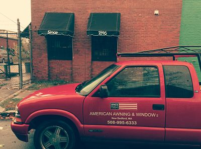 Canvas awnings look right at home on an old brick building.