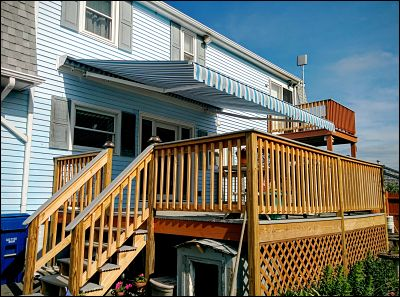 A gorgeous motorized awning that will shade this generously sized deck for years to come.