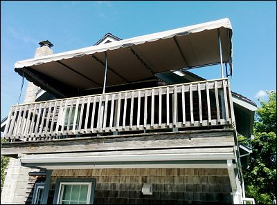 This second floor deck awning was a real design challenge to put together.