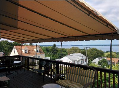 A pipe frame awning with stationary frame in Tiverton, Rhode Island.