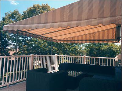 A patio canopy that covers half of a deck will provide shade when you want with the option of hanging out in the sun.