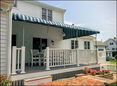 A pipe frame patio canopy covers this deck in Plymouth, MA.