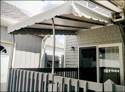 A vinyl patio canopy in Fairhaven, MA made out of one solid piece of fabric so it can stay up year round.