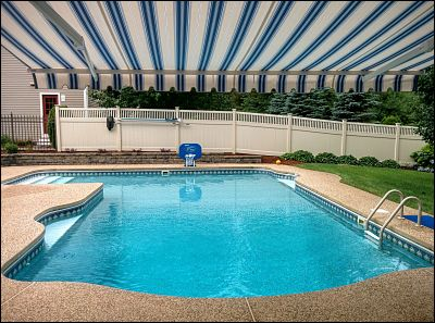 The view from underneath this poolside retractable awning.