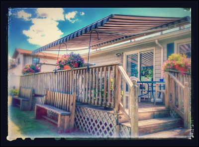 A very cool picture of a retractable awning over a back deck in Fairhaven, MA.