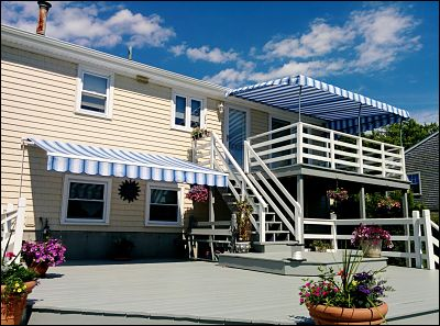 Upper and lower deck with both a stationary awning as well as a retractable awning.