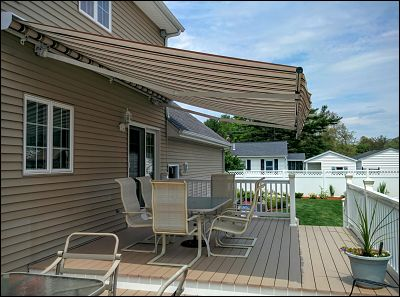 The awning, now fully extended, gives substantial shading to the dining area and more.