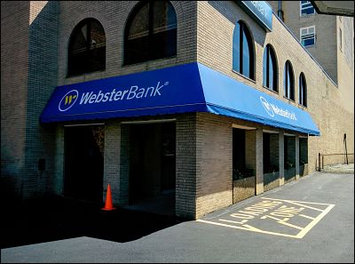 A wrap-around the corner style awning for Webster Bank in downtown New Bedford.