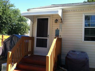 Another back door aluminum awning that will protect homeowners coming and going.