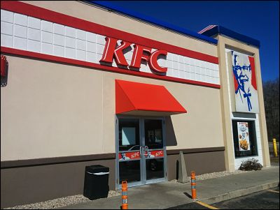 A bright red awning matches K.F.C's colors perfectly.