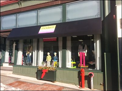 Storefront awning with custom graphics for Modern Exchange Consignment in Downtown New Bedford.
