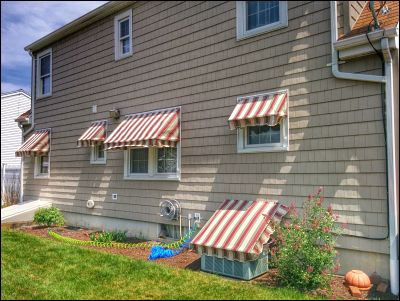 Window awnings can not only provide a cool new look, but can also lower indoor temperatures up to 15 degrees!
