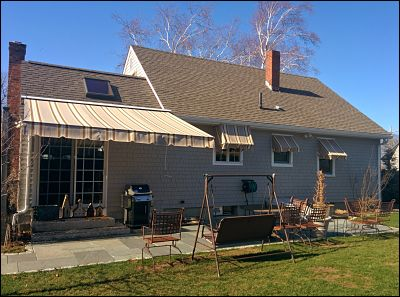 Good looking recovers for  both window awnings as well as this customer's retractable.