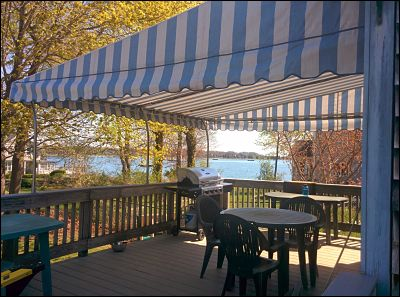 A beautiful patio canopy covering this deck by the water in South Dartmouth, MA.