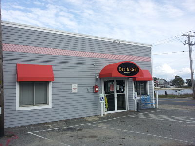 This restaurant in Onset, MA received a recover on existing awning frames that gave the whole building an eye catching new look