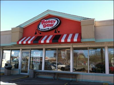 Take it from a larger company, like Honey Dew Donuts, and add an awning to complete the look of your building.